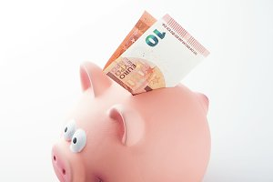 A piggy bank with bills on white background. Isolated.