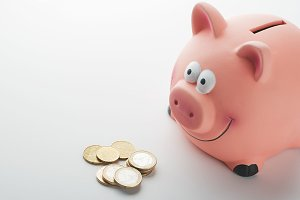 Piggy bank and coins on white background. Isolated.