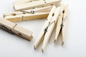 Various wooden clothespin on white background. Isolated.
