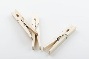 Three wooden clothespin on white background. Isolated. Horizontal shoot.