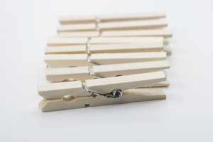 Wooden clothespins on white background. Isolated. Horizontal shoot.