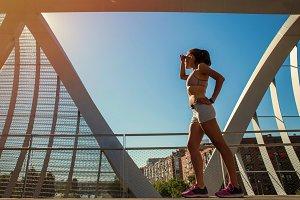 female runner sunbathing