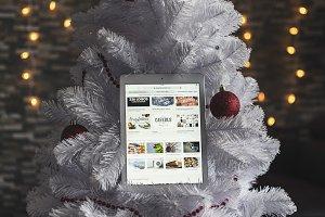 White Ipad on Holiday Christmas Tree