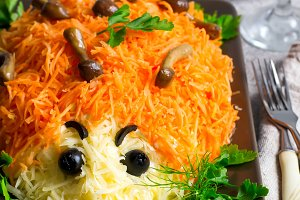 colorful salad is decorated in the form of a hedgehog. idea for