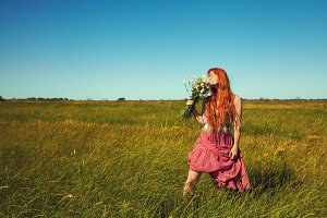 redhead woman with a bouquet of flowers