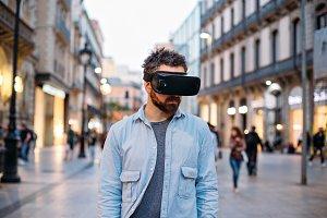 Hipster man uses VR glasses