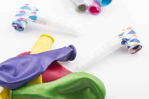 Balloons and party items on white background. Horizontal shoot.