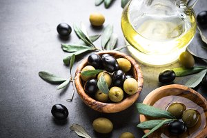 Black and green olives and olive oil.