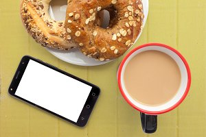 smartphone bagel and coffee