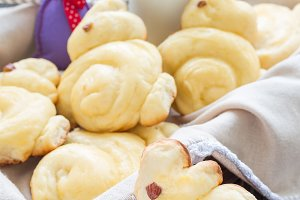Homemade sweet buns made in bunny shape served with bottle of milk, vertical