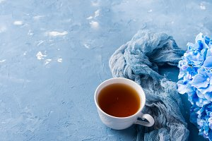 Cup of tea on blue
