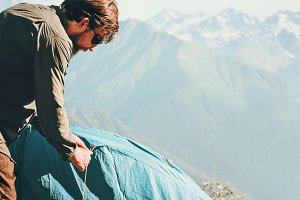 Man Traveler with tent camping