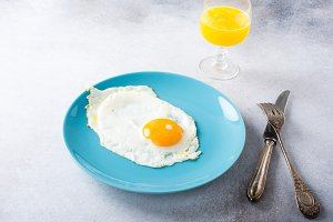 Fried egg and orange juice