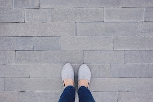 Selfie of feet and shoes on pavement