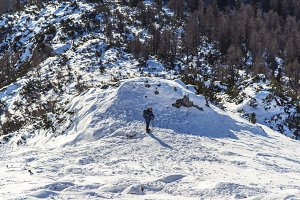 Hiker climbing in a winter landscape