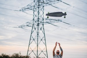 Boy launches skateboard up