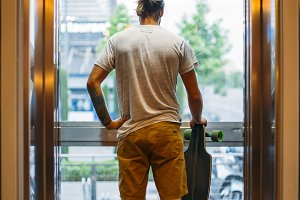 Boy in elevator with skateboard