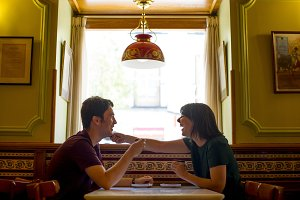 Boy and girl having coffee