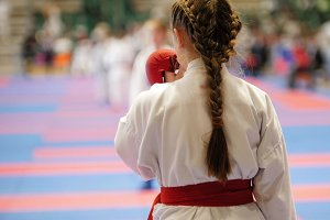Young karateka preparing for sparing with the competitor