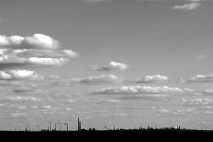 Industrial landscape - silhouette in front of clouds - black and whitee