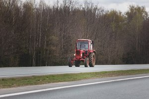 Tractor moving on highway