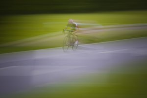 bicycles road racing blurred motion