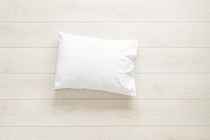 white pillow on the floor