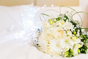 Bouquet of roses in bed