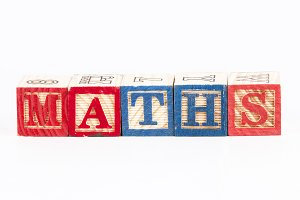 Maths word with wooden blocks