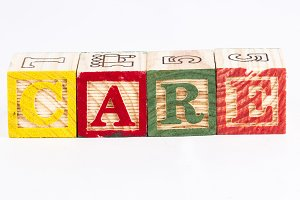 Care word with wooden blocks