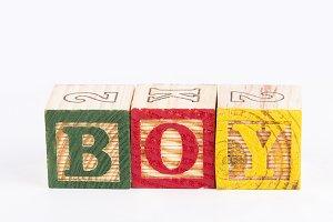Boy word with wooden blocks