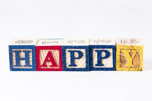 Happy word with wooden blocks