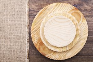 Background of napkin and wooden plates on wooden background. Copy space.