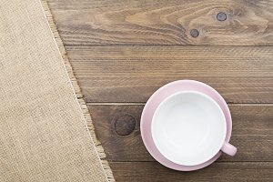 Background of napkin next to ceramic ware on wooden background. Copy space.