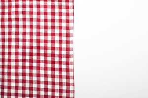 Background of tablecloth kitchen tablecloth on white background. Copy space.