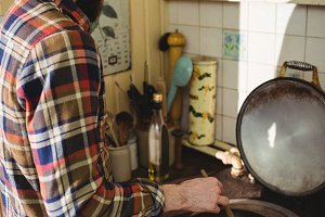 Man preparing food in kitchen