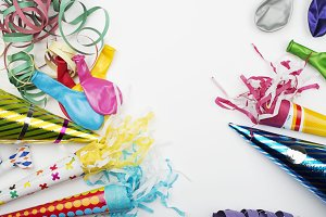 Background of party items and celebrations on white background. Horizontal shoot.