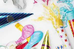 Background of party items and celebrations on white background. Vertical shoot.