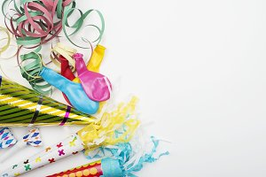 Various party supplies and celebrations on white background. Horizontal shoot.