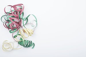 Colorful ribbons of a party on white background. Celebration.