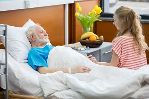 senior patient in hospital bed
