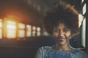 Curly girl in suburban train