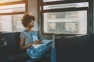 Afro girl in suburban electric train