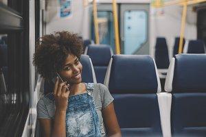 Girl speaking on phone in train