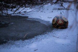 Ball Frozen in Pond in Wisconsin