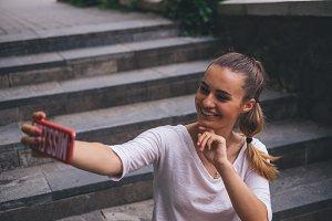 Happy woman doing selfie