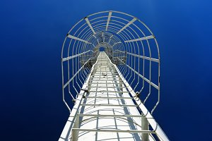 Staircase in blue sky