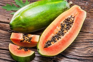 Papaya fruit on wood