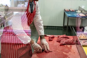 Butcher chopping red meat