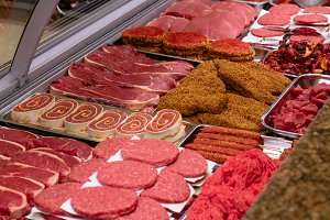 Variety of marinated meat at display counter